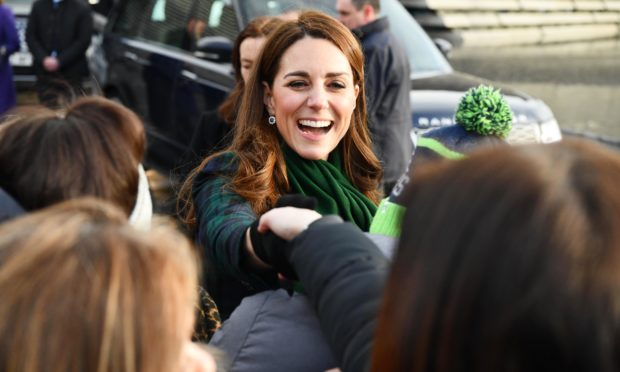 Kate greets members of the public on the waterfront during a walkabout. Andrew Parsons / i-Images
