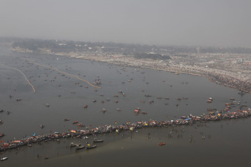 "An aerial view of Kumbh city at Sangam, on the auspicious day of ""Paush Purnima"" during Kumbh Mela or Pitcher Festival at Prayagraj, India, .The Kumbh Mela is a series of ritual baths by Hindu holy men, and other pilgrims at the confluence of three sacred rivers the Yamuna, the Ganges and the mythical Saraswati that dates back to at least medieval times."