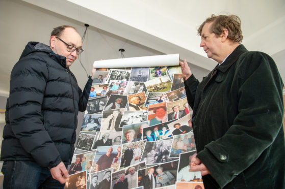 Grant Hutchison (Tustee of the Charity) gives a sneak preview of the wallpaper which will adorn the new venue to Paul Roberts (Secretary of the City of Brechin Civic Trust).