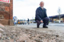 Taxi driver Alex Marshall surveys the mess left by  pigeons on Monifieth High Street.
