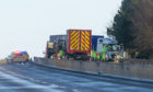 A lorry on the A90 near Brechin following a crash earlier this year.