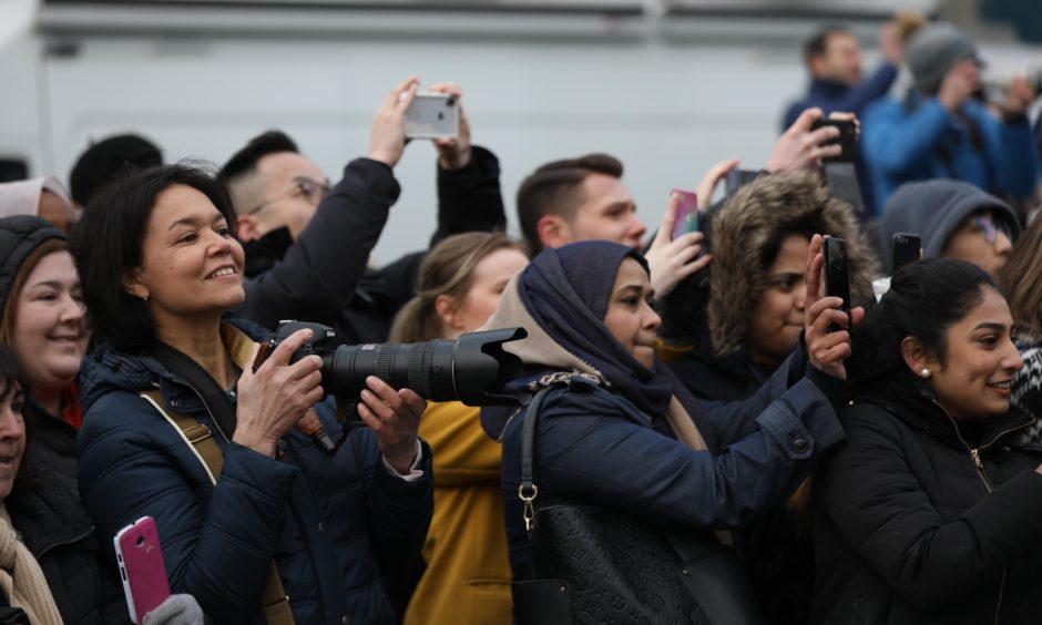 Members of the public wait for the royal couple to leave the V&A. Mhairi Edwards / DCT Media