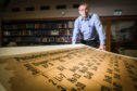 Professor David O'Hagan with the recently conserved periodic table.