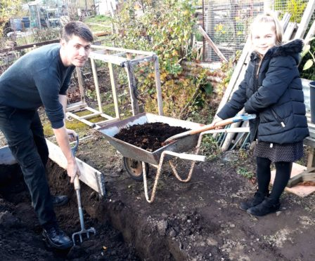 Kyle and Scarlet digging and composting