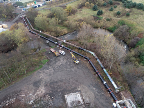 These latest aerial photographs show the new pipe modelling its hardwearing, hand painted, sheer black finish sitting next to its greying older sibling which will soon be put out to pasture.