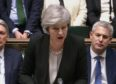 Prime Minister Theresa May addresses MPs following the vote