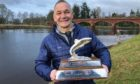 Philip Black with the Malloch Trophy.