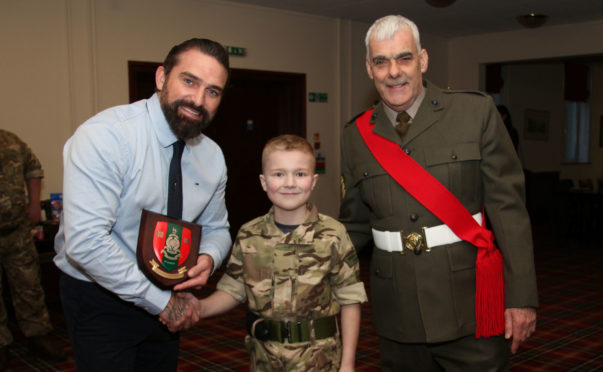 Cadet Daniel Baldwin, who received the Belle Isle Cup top award, presenting Ant Middleton with a Troop 181 Plaque with cadet instructor Colour Sergeant Derek McNulty.