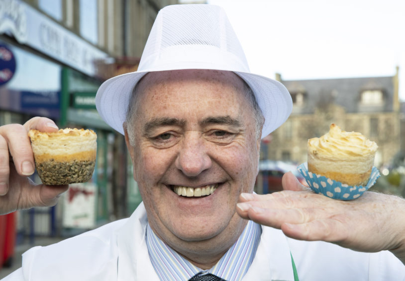 Fraserburgh based butcher Alistair Bruce celebrating as his haggis cupcakes scooped top prize in the Scottish Craft Butchers Haggis Products Awards.