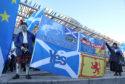 Campaigner John Love holds a banner at an Independence demonstration outside the Scottish Parliament in Edinburgh.