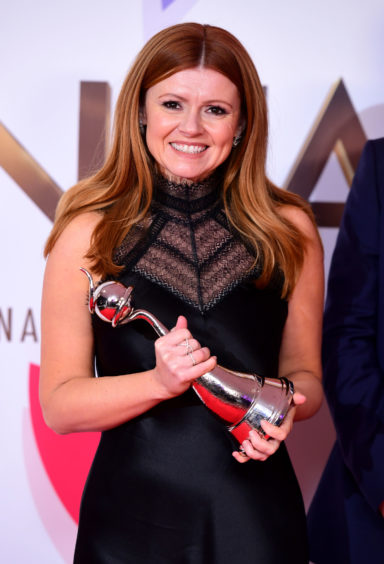 Sian Gibson with the award for Best Comic for Peter Kay's Car Share.
