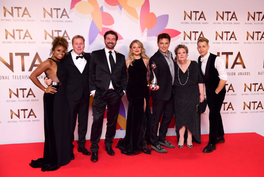 Fleur East, Harry Redknapp, Nick Knowles, Emily Atack, John Barrowman, Anne Hegerty and James McVey with The Bruce Forsyth Entertainment Award for I'm a Celebrity Get Me Out of Here.