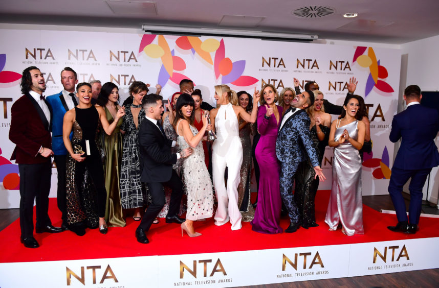 Claudia Winkleman and Tess Daly with the stars of Strictly Come Dancing which was crowned winner of the Best Talent Show category.