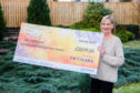 Courier News, Ross Gardiner Story, CR0005714 £2019 presentation - Pictures of Sarah Dow who won a cash prize of £2019 with The Courier competition. Picture shows Sarah Dow with the cheque. 2 Mansfield Road, Scone. Tuesday 22nd January 2019  Pic Credit - Steve MacDougall / DCT Media