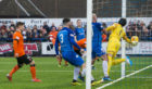 Dundee United's Pavol Safranko heads in from close range to open the scoring