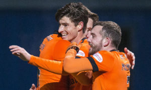 Ian Harkes celebrates with his team-mates after scoring his goal.