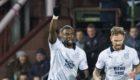 Dundee's Genseric Kusunga (L) celebrates his goal.