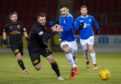 Livi's Craig Halkett battles with Tony Watt of St Johnstone.