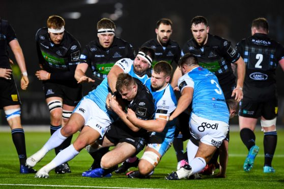 Warriors centre Stafford McDowall is tackled by Scott Baldwin at Scotstoun.