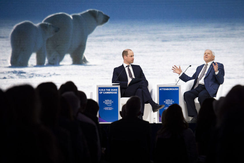 The broadcaster and natural historian, attend a session at the annual meeting of the World Economic Forum in Davos.