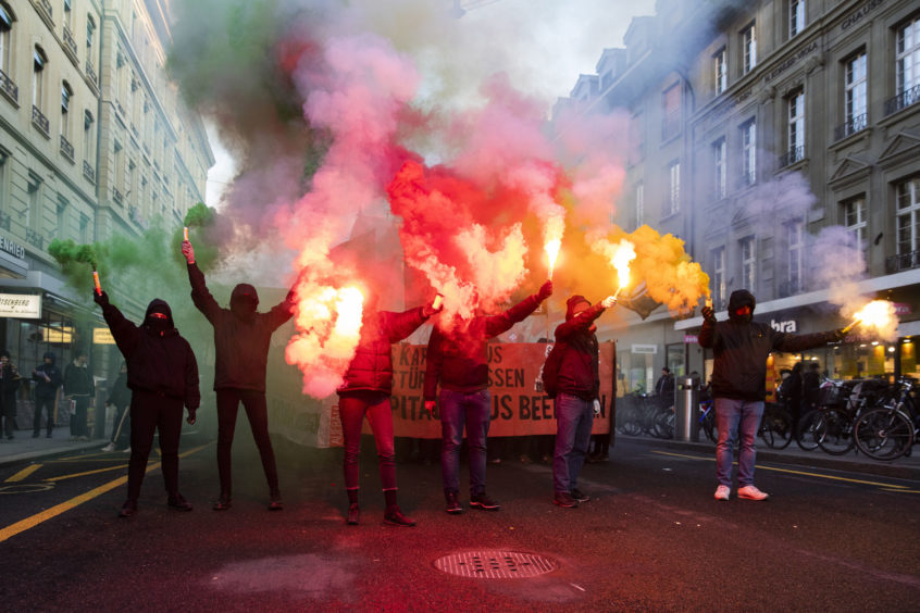 Protesters burn fireworks during a demonstration against the World Economic Forum (WEF) in Bern, Switzerland.