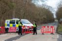 Police closed to the road to investigate a fatal accident on December 31