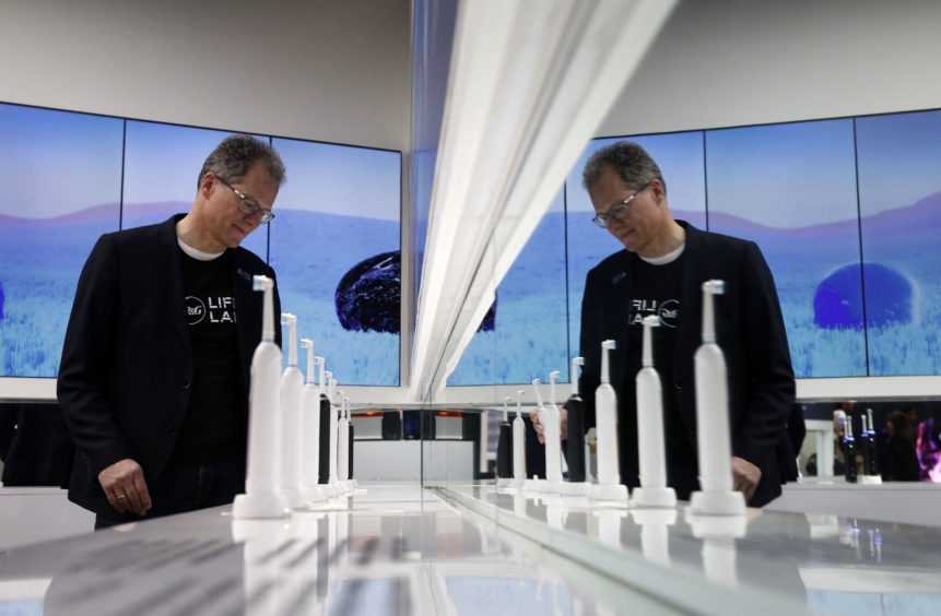 Hansjoerg Reick looks at a display of Oral-B Genius X smart toothbrushes at the Procter & Gamble booth.