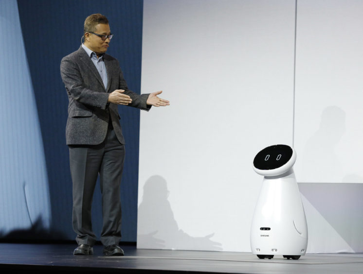 Gary Lee, senior vice president and head of the AI Center at Samsung Electronics, unveils the Bot Care robot.
