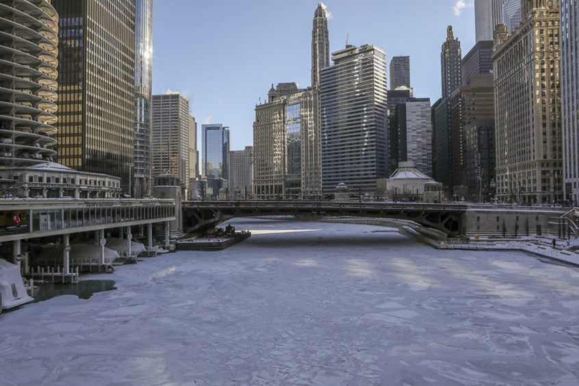 Ice covers the Chicago River Wednesday in Chicago. A deadly arctic deep freeze enveloped the Midwest with record-breaking temperatures triggering widespread closures of schools and businesses.