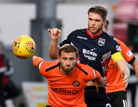 Marcus Fraser in action against Dundee United.