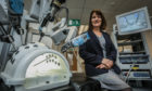 DIHS co-director Dr Vanessa Kay with the surgical robot.
