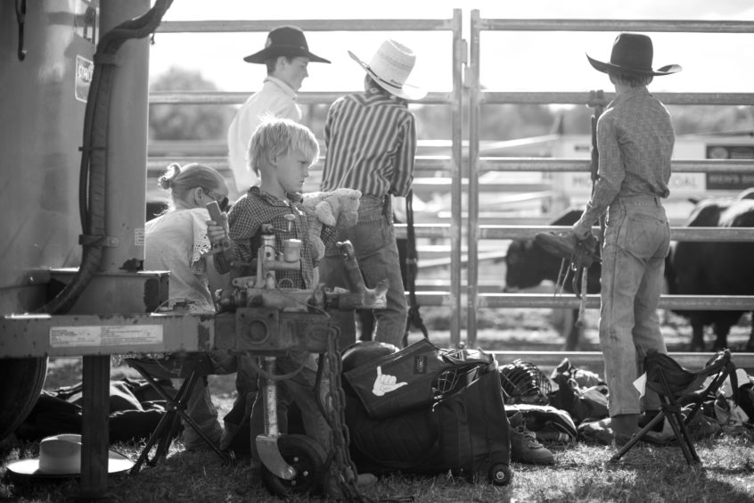 A young boys holds his teddy bear as the junior competitors prepare themselves for the steer ride of the Mudgee Show Rodeo n Mudgee, Australia.