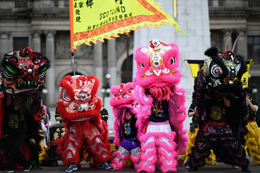 Members of the Glasgow Chinese community attend New Year celebrations for the Year of the Pig at George Square and the City Chambers, Glasgow
