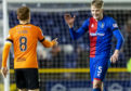 Inverness' Coll Donaldson with Dundee United captain Fraser Fyvie.