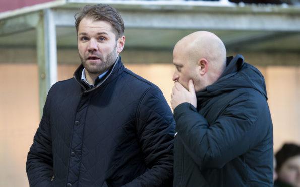 Gordon Forrest (right) talks tactics with Robbie Neilson.