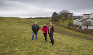 Angela with partner David Hall (right) and neighbour David Bray.
