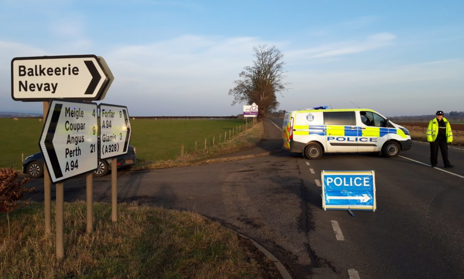 Police at the scene following the crash on the A84,
