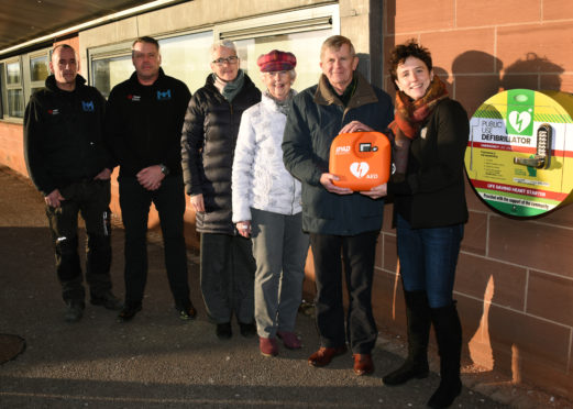 From right: Mairi Gougeon, David Milne (Rotary), Susan Coull (Inner Wheel), Melanie Cargill (First Responder),  electricians Bill Mustard and Chris Taylor