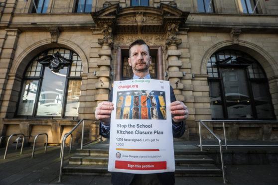 Councillor Dave Doogan with his petition against frozen school meals