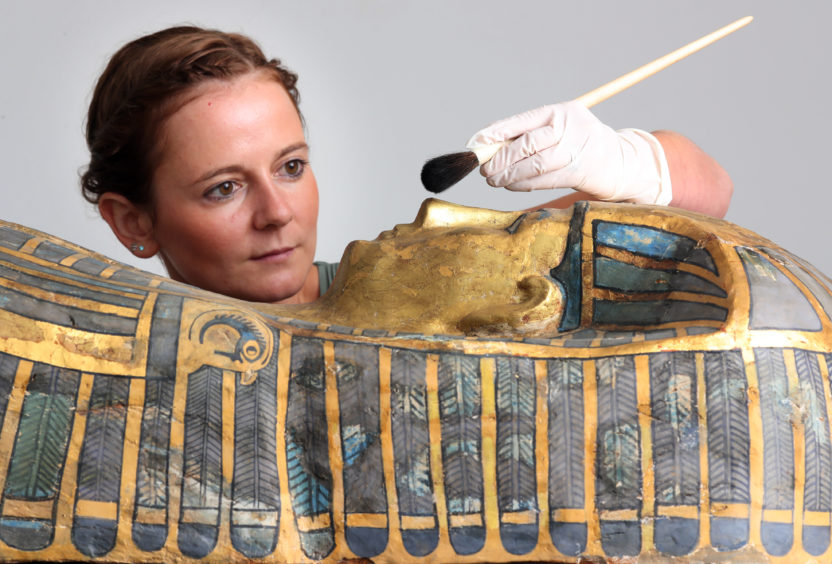 Assistant conservator Bethan Bryan works on the Qurna coffin.