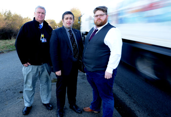 Councillor Smart, right, with Councillor Graham, centre, and Councillor Colin Davidson at the Standing Stane Road