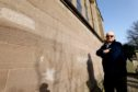 Session clerk Douglas Taylor beside some of the vandalism on Brechin Cathedral.