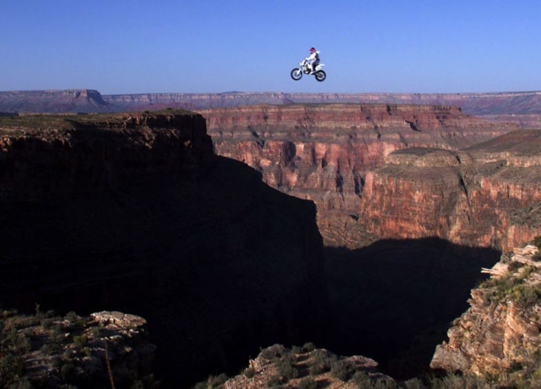 Robbie Knievel of the US is airborne above the Grand Canyon, AZ, 20 May, 1999 during a successful 228 feet (some 68 meters) world record jump. Knievel crashed following his landing and sustained unknown injuries but talked to the crowd before being flown by helicopter to the University Medical Center in Las Vegas, NV.