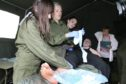 Students taking part in a simulation exercise on Magdalen Green.