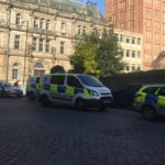 Seven police vehicles sent to raid on Community Justice Services after belt buckle mistaken for offensive weapon