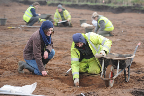 Claire Herbert (Archaeological Advisor to Angus Council) and Riccardo Caravello, one of the archaeological team at work, Balmachie Road, Carnoustie.