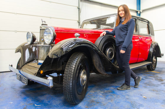 Auction administrator Jade Bloomer with the 1933 Sunbeam 25 Limousine