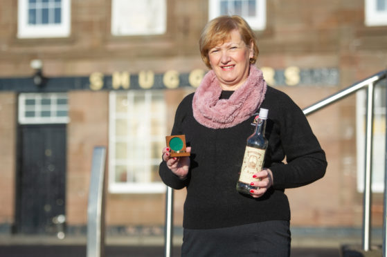 Courier News - Angus - Jim Millar story; CR0005899 Tales of a ghostly piper have prompted an Angus councillor to call for more awareness of smuggling in the county.  Picture Shows; Councillor Brenda Durno with some of the Smugglers Tavern curios, Smugglers Tavern, East Grimsby, Arbroath Harbour, Arbroath, 01st February 2019. Pic by Kim Cessford / DCT Media