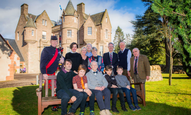 On the bench, left to right, is Alastair Hughson (grandson), Jamie Hughson (great grandson), Tom Wilson, Miller Spencer (great grandson) and Jude McCraw (great grandnephew). Standing, left to right is Pipe Major Alastair Duthie, Rosslyn Spencer (granddaughter), Glynis McCraw (niece), Derek McCraw (Glynis's husband), Doreen Wilson (Tom's daughter), George Wilson (son-in-law), Lt Col R M Riddell (Chair of The Black Watch Association) and Major R J W Proctor MBE (Secretary, The Black Watch Association).
