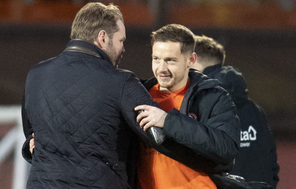 Dundee United manager Robbie Neilson at full-time with new signing Peter Pawlett.